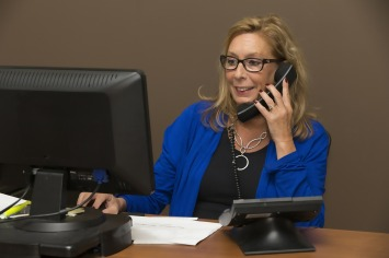 Woman at desk answering the phone