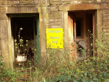Danger sign on abandoned building